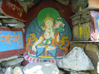 White Tara in grotto - click for a larger image